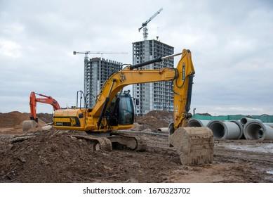 Minsk, Belarus, Marc 06, 2020: Excavator JCB JS 220 SC working at construction site