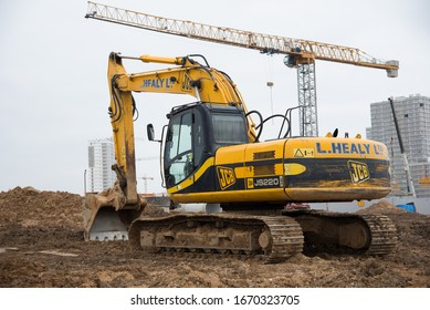Minsk, Belarus, Marc 06, 2020: Excavator JCB JS 220 LC working at construction site