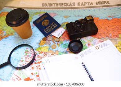 Minsk/ Belarus - March 11 2018: Flat lay photo with camera, notebook and documents on the map. Travel concept
