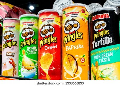 Minsk, Belarus, March 13, 2019: Variety of Pringles Potato Chips display in the supermarket shelve.
