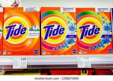 Minsk, Belarus, March 13, 2019: Washing Powder Tide on shelves in store