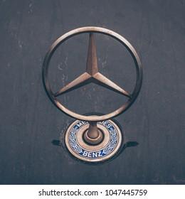 Minsk, Belarus, March 14, 2018: Emblem of Mercedes Benz close-up on the hood, Mercedes star in crisis, bankruptcy, German quality, Mercedes logo