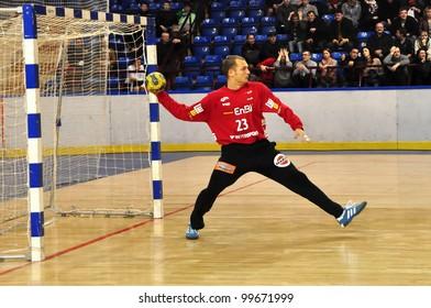 MINSK, BELARUS - MARCH 18: EHF cup 2012, DYNAMO Minsk VS  FRISCH Goppingen: Goalkeeper Rutschmann Bastian (Goppingen) enters the ball into play on March 18, 2012 in Minsk, Belarus