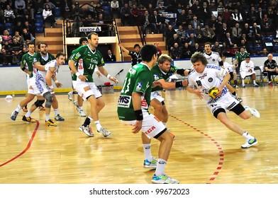 MINSK, BELARUS - MARCH 18: EHF cup 2012, DYNAMO Minsk VS  FRISCH Goppingen: Pavel Atman (DYNAMO (white) controls the ball on March 18, 2012 in Minsk, Belarus