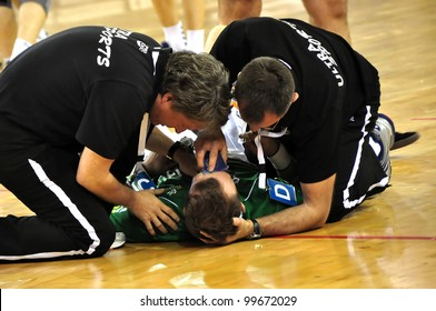 MINSK, BELARUS - MARCH 18: EHF cup 2012, DYNAMO Minsk VS  FRISCH Goppingen: unidentified people providing first aid to injured handball player on March 18, 2012 in Minsk, Belarus