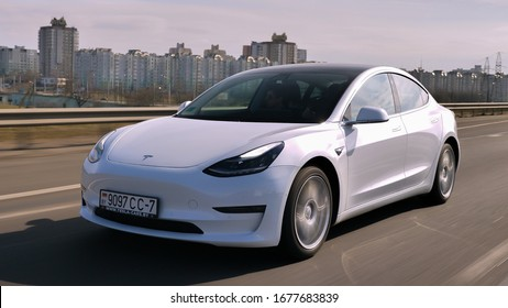 MINSK, BELARUS - MARCH 20, 2020: Tesla Model 3 Performance drives on a highway. It has dual motor all-wheel drive, total output is 451 hp. Model 3 is the best-selling plug-in electric vehicle.