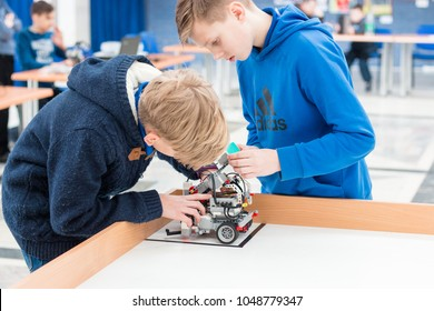 Minsk, Belarus. March, 2018. Boys construct and code robots. Lego Mindstorms EV 3 competition. STEM education.  Concept of battle. Robotics class for child and teen. School.  Mathematics. Science.
