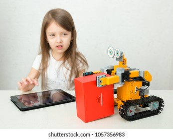 Minsk, Belarus - March, 2018. A little girl is an elementary school. She is playing with Jimu Robot. Ubtech. Modern training. STEM education. Code the bot. Robotics. Progressive American education.