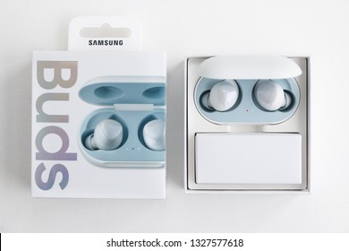 Minsk, Belarus. March, 2019. The new flagship phone Galaxy S10e known worldwide company Samsung, which was announced in February. Unpacked smartphone with all accessories. Wireless Buds headphones.