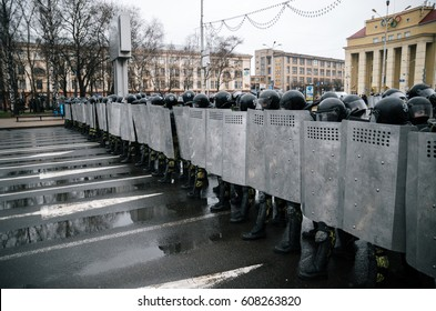 Minsk, Belarus - March 25, 2017 - Police unit with shields against ordinary citizens and protesters. Belarusian people participate in the protest against the decree 3 Lukashenko and the authorities