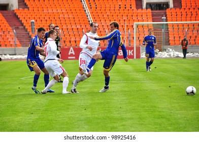MINSK, BELARUS - MARCH 25: unidentified players during the match between FC BATE Borisov(blue) and FC MINSK on March 25, 2012 in Minsk, Belarus
