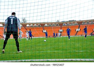 MINSK, BELARUS - MARCH 25:FC Bate Borisov VS FC MINSK, Artur Lesko, goalkeeper (FC MINSK) VS Renan Bressan(FC BATE (blue) penalty kick on March 25, 2012 in Minsk, Belarus
