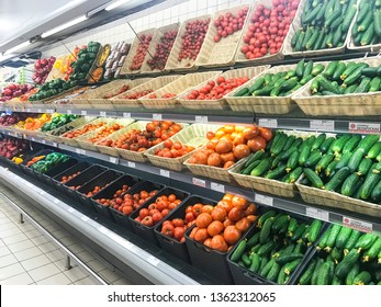 Minsk, Belarus - March 26, 2019: Shelves with vegetables and fruits from various manufacturers in hypermarket.