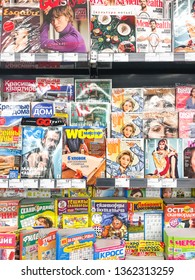 Minsk, Belarus - March 26,2019: Popular magazines and books from various manufacturers on supermarket shelves.