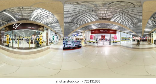 MINSK, BELARUS - MARCH 4, 2015: Panorama of interior in modern trade centre with shoe shops. Full spherical 360 by 180 degrees seamless panorama in equirectangular projection. VR content