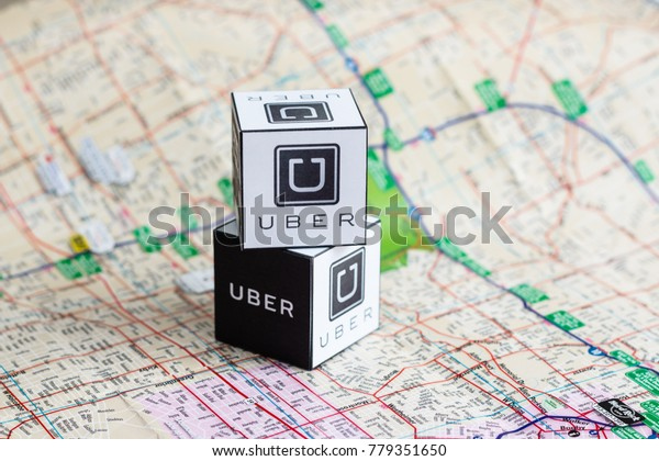 Minsk, Belarus - March 5, 2017: Uber logo.  Service. Handmade. Well known service all around the world. City taxi service.
