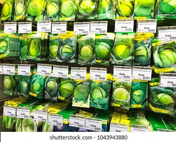 Minsk, Belarus - March 9, 2018: Shelves in the store for sale with vegetable seeds for planting in the garden of various manufacturers.