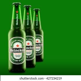 MINSK, BELARUS - MAY 05, 2016: Cold bottles of Heineken Lager Beer with drops over green background. Heineken is the flagship product of Heineken International