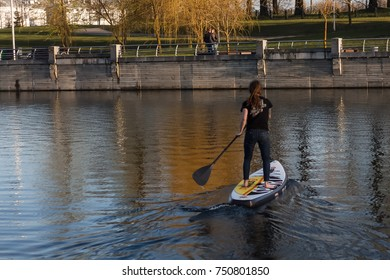 MINSK, BELARUS - MAY 06,2017 - People is riding on SUP boards on water in city