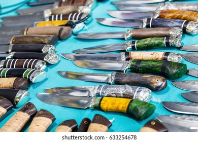 MINSK, BELARUS - MAY 1, 2017: Hunting knives and knifes of large and small sizes lie on a table in a hunting and fishing store