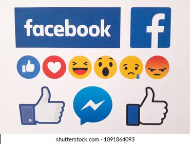 Minsk, Belarus - May 11, 2018: Facebook thumbs up signs and 6 Empathetic Emoji reactions printed on white paper