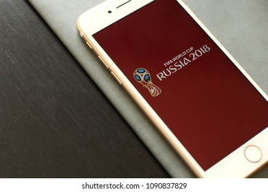 MINSK, BELARUS – May 12, 2018: White Apple iPhone 7. The official logo of the football World Cup in Russia 2018.