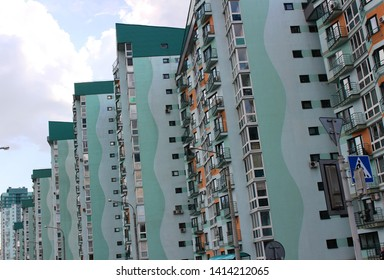 Minsk. Belarus. May 13, 2019. View from the avenue to a new multi-apartment high-rise building of a greenish hue. Construction for people in need of housing.