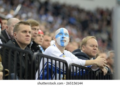 MINSK, BELARUS - MAY 16: Fans of Finland during 2014 IIHF World Ice Hockey Championship match at Minsk Arena on May 16, 2014 in Minsk, Belarus.