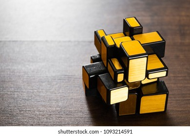Minsk, Belarus - May 17, 2018:  mirror magic cube on wooden background. with copy space.