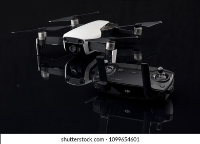 MINSK, BELARUS - MAY 17, 2018: DJI MAVIC AIR -  compact drone by DJI with 12 MP 4K HDR camera, with remote control unit.