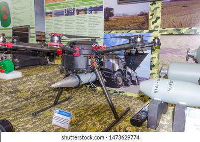 "Minsk, Belarus - MAY 18, 2019: International Exhibition of Arms and Military Equipment ""MILEX-2019"", multifunctional multicopter combat strike drone ""Grach"", with kamikaze target load."