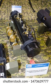 """Minsk, Belarus - MAY 18, 2019: International Exhibition of Arms and Military Equipment """"MILEX-2019"""", grenade bomb spreader for small multifunctional multicopter drone """"Grach""""."""