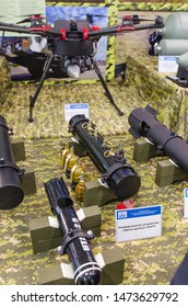 """Minsk, Belarus - MAY 18, 2019: International Exhibition of Arms and Military Equipment """"MILEX-2019"""", multifunctional multicopter combat strike drone """"Grach"""", and various target load device and weapon."""