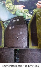 """Minsk, Belarus - MAY 18, 2019: International Exhibition of Arms and Military Equipment """"MILEX-2019"""", armor plate for body armor in holes and cracks from bullets."""