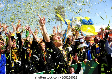 MINSK, BELARUS MAY 20: Unidentified players (FC NAFTAN) celebrate their victory in final cup match between FC NAFTAN and FC MINSK on May 20, 2012 in Minsk, Belarus