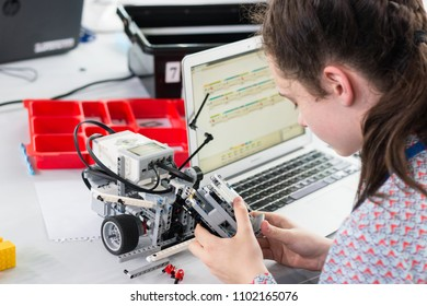"Minsk, Belarus. May, 2018. ""5th Minsk Open Robotics Tournament"". Robotics competitions. Girls construct and code Robot Lego Mindstorms EV3 on MacBook Apple. STEM."