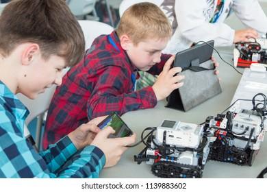 "Minsk, Belarus. May, 2018. ""5th Minsk Open Robotics Tournament"". Robotics competitions. Boys and girls construct and code Robot Lego Mindstorms EV3. STEM education."