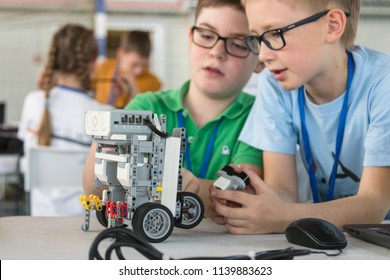 "Minsk, Belarus. May, 2018. ""5th Minsk Open Robotics Tournament"". Robotics competitions. Boys and girls construct and code Robot Lego Mindstorms EV3. STEM education."