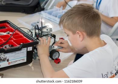 "Minsk, Belarus. May, 2018. ""5th Minsk Open Robotics Tournament"". Robotics competitions. Boys and girls construct and code Robot Lego Mindstorms EV3. STEM."