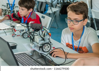 "Minsk, Belarus. May, 2018. ""5th Minsk Open Robotics Tournament"". Robotics competitions. Boys and girls construct and code Robot Lego Mindstorms EV3. STEM."