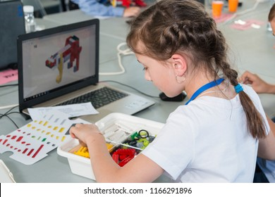 """Minsk, Belarus. May, 2018. """"5th Minsk Open Robotics Tournament"""". Robotics competitions. Boys and girls construct and code Robot Lego WeDo. STEM education."""