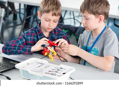 "Minsk, Belarus. May, 2018. ""5th Minsk Open Robotics Tournament"". Robotics competitions. Boys and girls construct and code Robot Lego WeDo. STEM education."