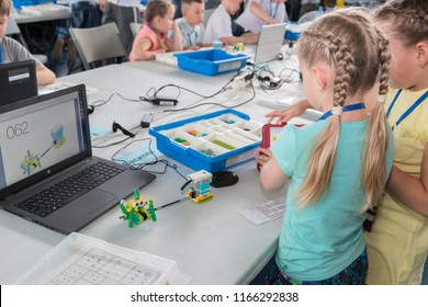 """Minsk, Belarus. May, 2018. """"5th Minsk Open Robotics Tournament"""". Robotics competitions. Boys and girls construct and code Robot Lego WeDo 2.0. STEM education."""