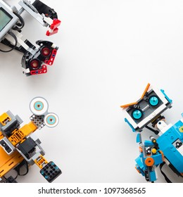Minsk, Belarus. May, 2018. Three robots: Lego Boost, Lego Mindstorms EV3 and Jimu Ubtech. Flat Lay. STEM education. Technology.
