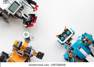 Minsk, Belarus. May, 2018. Three robots: Lego Boost, Lego Mindstorms EV3 and Jimu Ubtech. Flat Lay. STEM education. Technology.