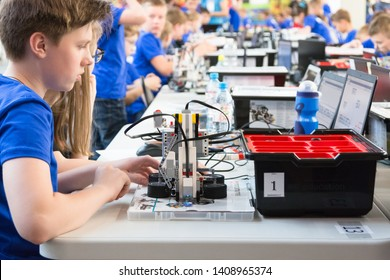 Minsk, Belarus. May, 2019. Boys and girls construct and code robots. Lego Mindstorms EV 3 robot. STEM education.   Robotics class for child and teen. STEAM. Mathematics. Science. Technology. Art.