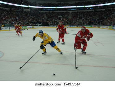 MINSK, BELARUS - MAY 22: MOLLER Oscar of Sweden and GOTOVETS Kirill of Belarus battle for the puck during 2014 IIHF World Ice Hockey Championship quarterfinal match on May 22, 2014 in Minsk, Belarus.