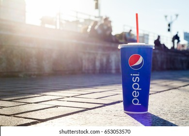 Minsk, Belarus, may 23, 2017: Drink Pepsi on the background of city life. Pepsi is a carbonated soft drink produced PepsiCo