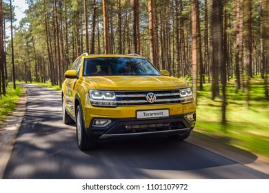 MINSK, BELARUS - MAY 28, 2018: Volkswagen Teramont (known as Atlas in the USA) drives on a narrow road throught a forest during test-drive on a sunny day.