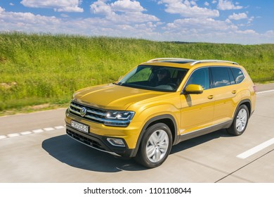 MINSK, BELARUS - MAY 28, 2018: Volkswagen Teramont (known as Atlas in the USA) drives on a road outside a city during test-drive. Volkswagen Teramont / Atlas is a three-row seven-seater crossover.